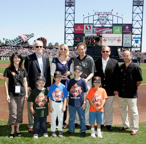 Giants Community Fund Executive Director Sue Petersen and San Francisco Giants Executive Vice President and COO Larry Baer